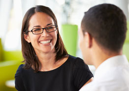 Woman in glasses meeting with her dentist
